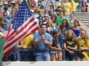 Andrew Mason '15 shows his spirit with full denim gear and an American flag